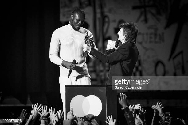 Stormzy accepts the Best Male Solo Artist award from Ronnie Wood during The BRIT Awards 2020 at The O2 Arena on February 18 2020 in London England