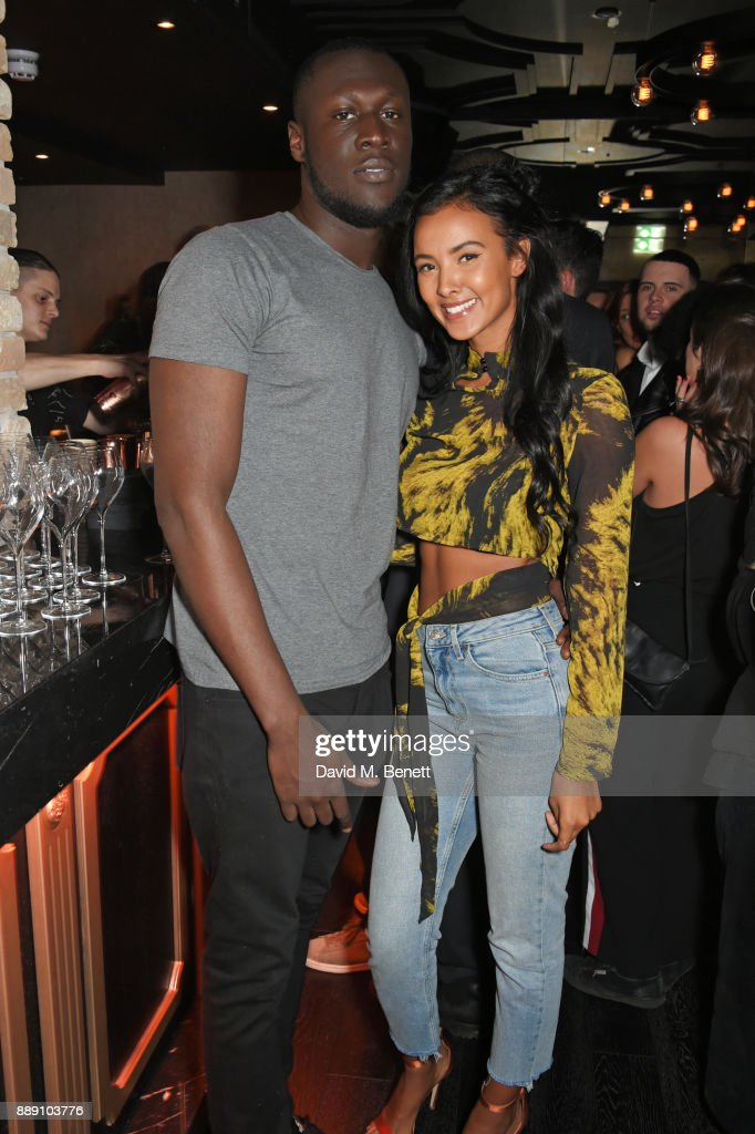 Stormzy (L) and Maya Jama attend Idris Elba's Christmas Party at Kadie's Cocktail Bar & Club on December 9, 2017 in London, England.