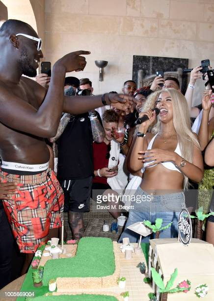 Stormzy and Maya Jama speak before cutting his cake as Spotify Premium throws the ultimate party in Spain for Stormzy's 25th birthday on July 26 2018...