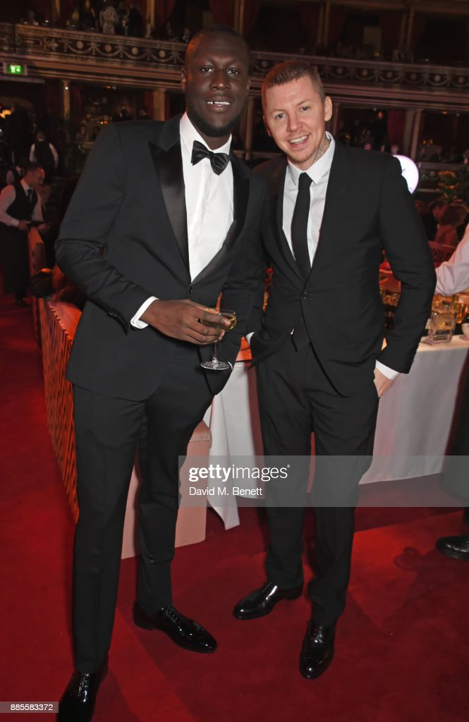 Stormzy (L) and Professor Green attend a drinks reception ahead of The Fashion Awards 2017 in partnership with Swarovski at Royal Albert Hall on December 4, 2017 in London, England.