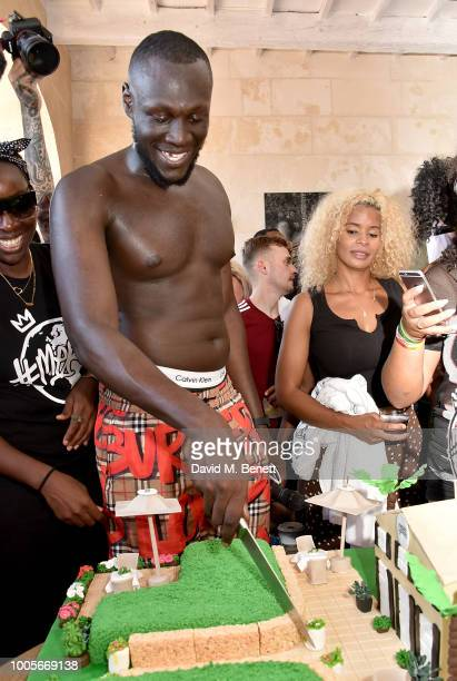 Stormzy cuts his cake as Spotify Premium throws the ultimate party in Spain for his 25th birthday on July 26 2018 in Menorca Spain