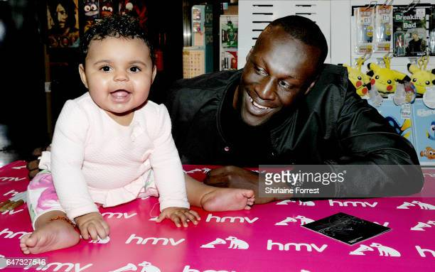 Stormzy meets infant fans and signs copies of his new album 'Gang Signs And Prayer' at HMV Liverpool One on March 2 2017 in Liverpool United Kingdom
