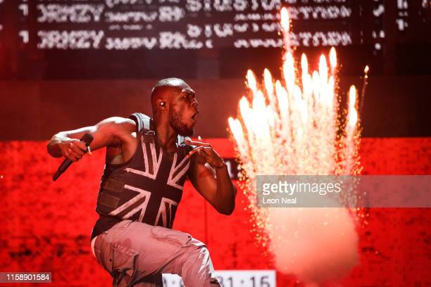 Stormzy performs in the headline slot on the Pyramid Stage on day three of Glastonbury Festival at Worthy Farm, Pilton on June 28, 2019 in...