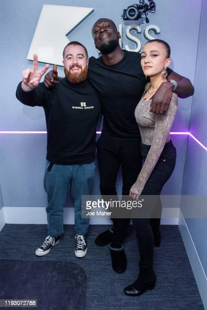 Stormzy pictured with Tom Green and Daisy Maskell visits KISS FM on December 10 2019 in London England
