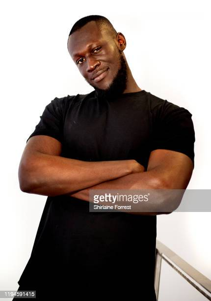 Stormzy poses after meeting fans and signing copies of his new album 'Heavy Is The Head' during an instore session at HMV Manchester on December 17...