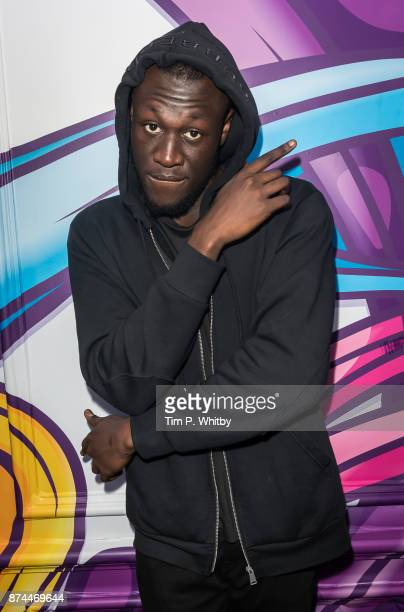 Stormzy poses for a photo during a visit to Kiss FM Studio's on November 15 2017 in London England
