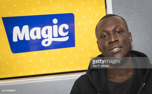 Stormzy poses for a photo during a visit to the Magic FM Studio's on November 15 2017 in London England