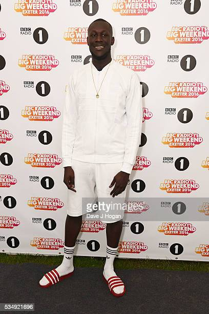 Stormzy poses for a photo during day 1 of BBC Radio 1's Big Weekend at Powderham Castle on May 28 2016 in Exeter England
