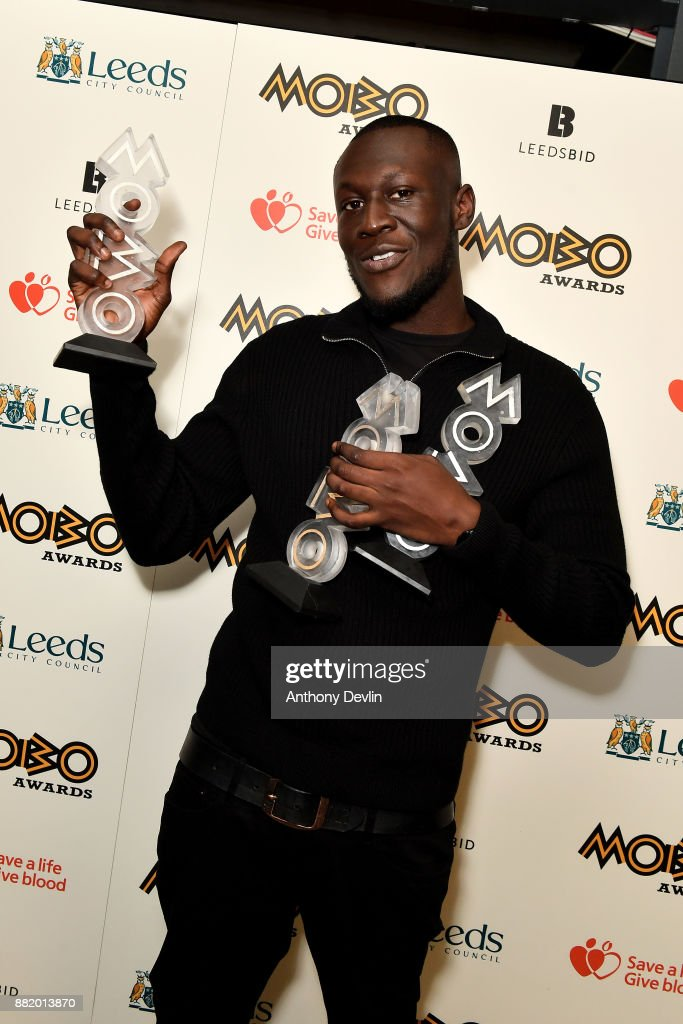 Stormzy poses in the winners room with the awards for Best Male, Best Grime and Best Album at the MOBO Awards at First Direct Arena Leeds on November 29, 2017 in Leeds, England.