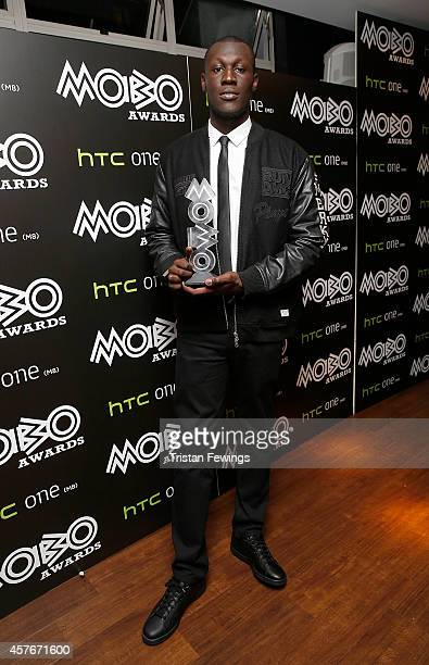 Stormzy poses with the MOBO award for Best Grime Act in the winners room at the MOBO Awards at SSE Arena on October 22 2014 in London England
