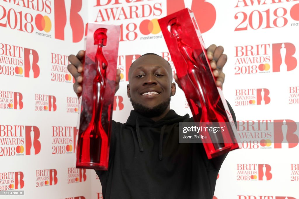 Stormzy, winner of the British Album of the Year and British Male Solo Artist awards, poses in the winners room during The BRIT Awards 2018 held at The O2 Arena on February 21, 2018 in London, England.