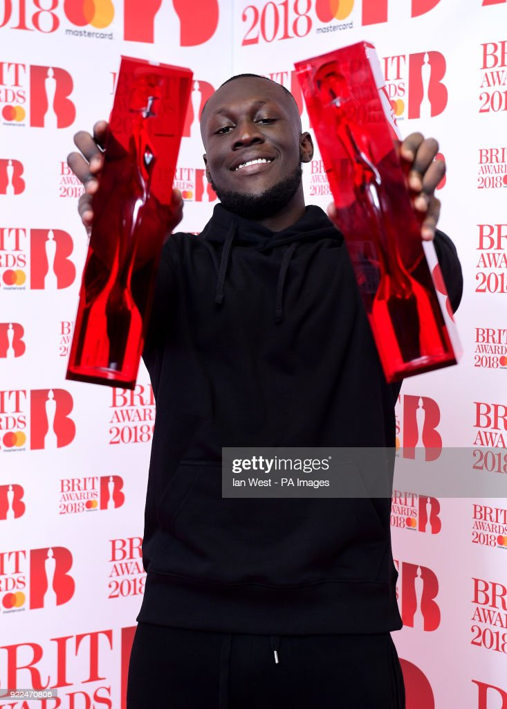 Stormzy with his British Album of the Year and British Male Solo Artist awards in the press room during the Brit Awards at the O2 Arena, London.