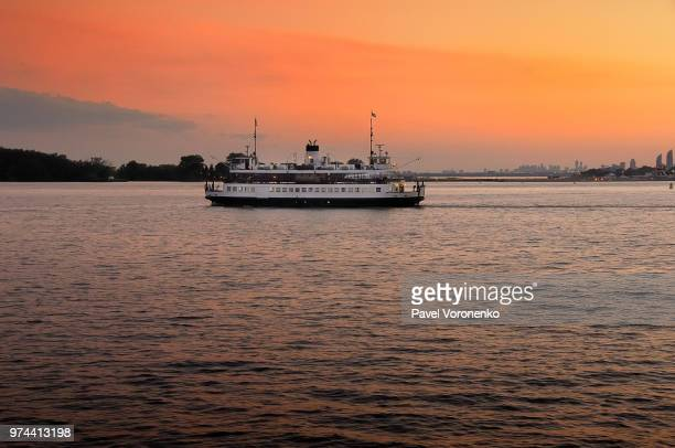 story about white ferry, red lake and amber sky - ferry stock pictures, royalty-free photos & images