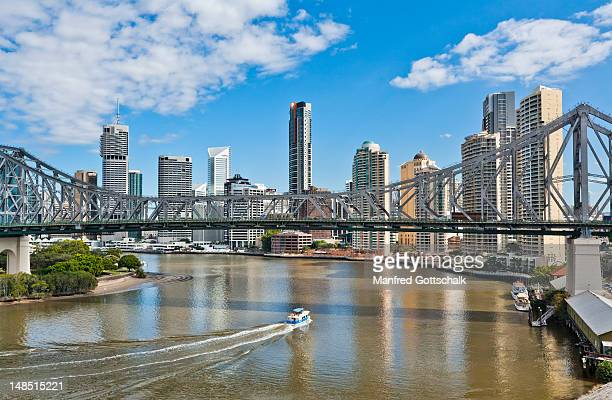Story Bridge and city skyline with Brisbane River and River Place Apartment Building in foreground.