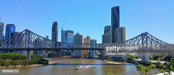 Story Bridge Over Brisbane River In City Against Clear Sky