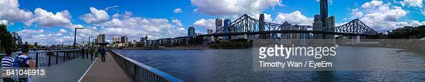 Story Bridge Over River In City Against Cloudy Sky