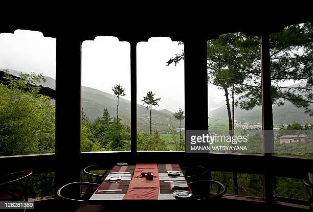 TOURISM story by Adam Plowright In this photograph taken on August 17 a view of the Paro valley is seen from the dining area of the luxury Uma Hotel...