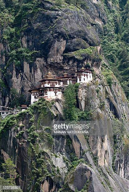 TOURISM story by Adam Plowright In this photograph taken on August 21 the Taktsang Monastery popularly known as the Tiger's Nest stands on a hillside...