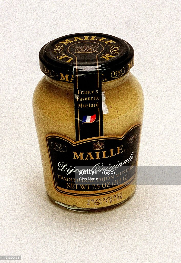 DIJON MUSTARD -- Story is on about Steak and ten various ways to Sear/ Smear/ Serve it; Steak Centerpiece; Condiment, Flavorings on the side , Wrap Around Pix, Tights , Neutral Background. : News Photo