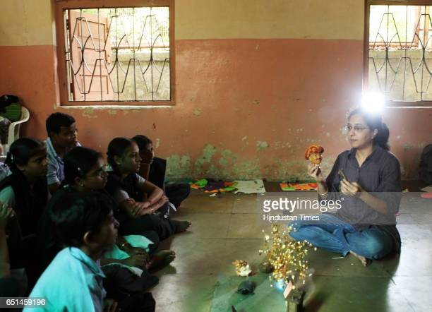Story telling workshop Children listening to stories at Tata Compound School at Andheri on Friday