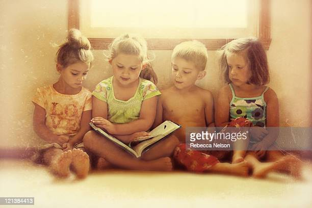 Story time for four children