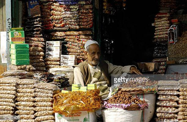 STORYAn Indian Kashmiri man waits for customers at his dates shop in Srinagar 16 October 2004 on the first day of the holy fasting month of Ramadan...