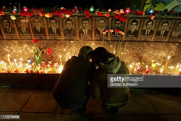 Chernobylnuclear25years A couple lights candles on April 2007 during the Chernobyl 21st anniversary commemoration ceremony in the city of Slavutich...