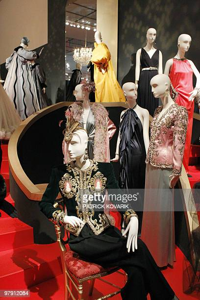 Major retrospective for fashion genius Saint Laurent Models of ball gowns are displayed during an exhibition dedicated to Yves SaintLaurent on March...