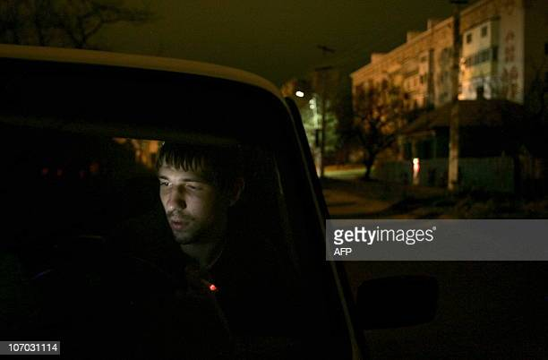 Massacre exposes anarchy, incompetence in rural Russia by Stuart Williams A taxi driver waits for a client in the village of Kushchevskaya in...