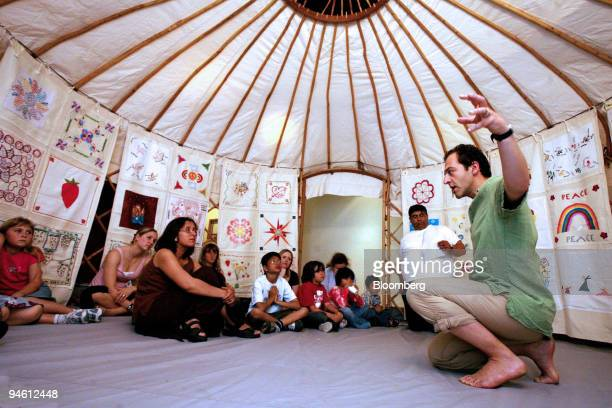 Storyteller Danny Scheinmann right entertains children and adults with stories inside a yurt during a free open day at Shakespeare's Globe Theatre in...