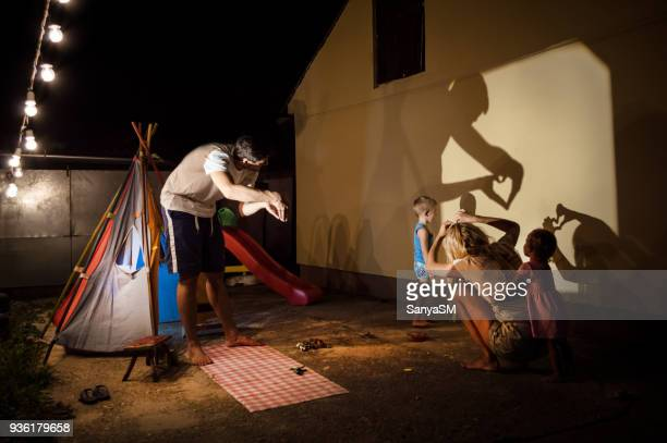 storytelling in our backyard - shadow puppet stock photos and pictures