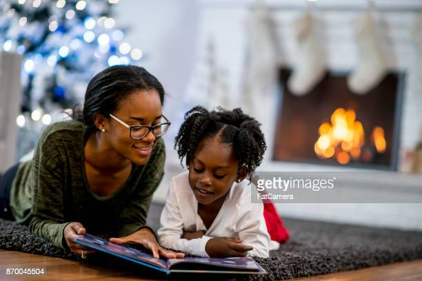 storytime - winter family stock photos and pictures