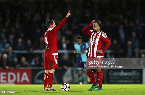 Stourbridge's Luke Benbow and Tom Tonks stand dejected after Wycombe Wanderers' Sam Wood scores his side's first goal of the game during the Emirates...