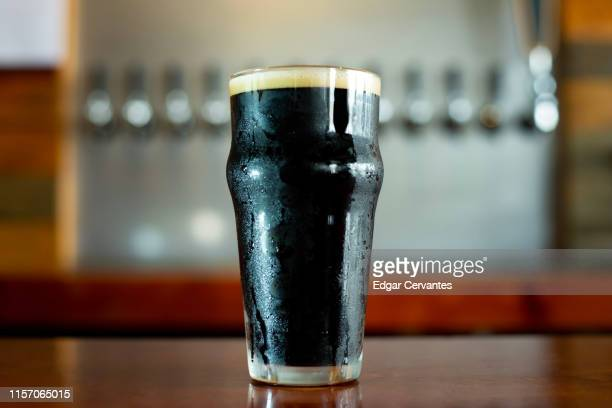 stout beer - pint glass stock pictures, royalty-free photos & images