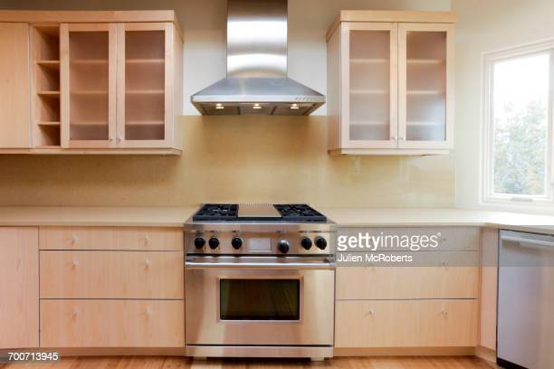 stove and hood in modern kitchen - cooker stock pictures, royalty-free photos & images