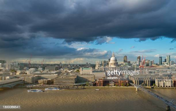 st.paul's cathedral in london cityscape, millennium footbridge across the thames river - skyline stock pictures, royalty-free photos & images