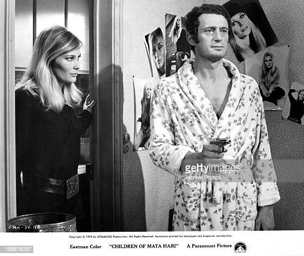 Stéphane Audran looks to a man in a scene from the film 'Only The Cool' 1970