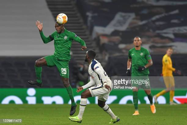 Stéphane BADJI of Ludogorets and Tanguy NDombele of Tottenham Hotspur battle for the ball during the UEFA Europa League Group J stage match between...