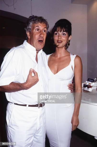 Stéphane Collaro et Caroline Barclay lors d'une fête le 24 juillet 1991 à SaintTropez France