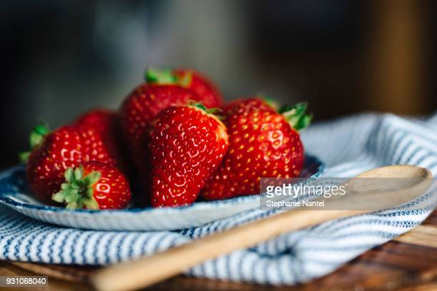 straberries and wood spoon - strawberry stock pictures, royalty-free photos & images