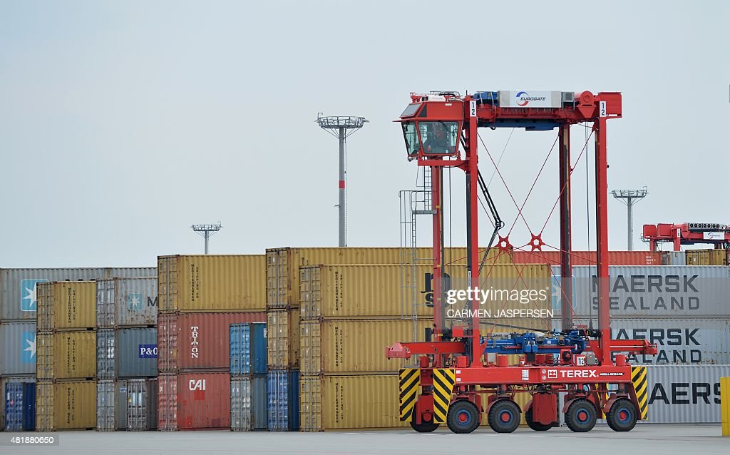 A Straddle Carrier Is Seen At The Jadeweserport In Wilhelmshaven