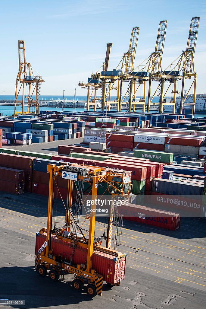 A straddle carrier moves a shipping container along the quayside at the commercial port in Barcelona, Spain, on Wednesday, Jan. 29, 2014. Government bonds in Europe's most-indebted countries rallied in the first three weeks of the year on signs the debt crisis that pushed those nations' borrowing costs to euro-era records had abated. Photographer: David Ramos/Bloomberg via Getty Images