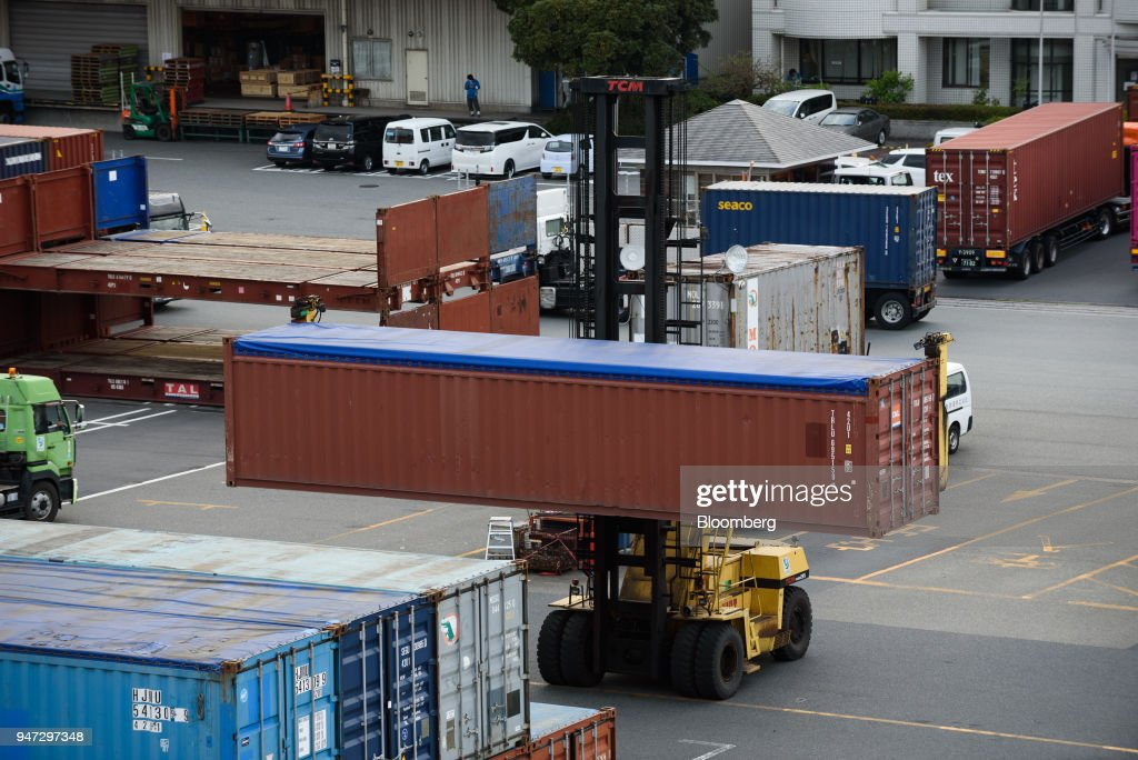 A straddle carrier transports a container at a shipping terminal in Yokohama, Japan, on Monday, April 16, 2018. Japan and China held their first high-level economic dialogue in almost eight years on April 16 against a backdrop of trade threats from the U.S. Photographer: Akio Kon/Bloomberg via Getty Images