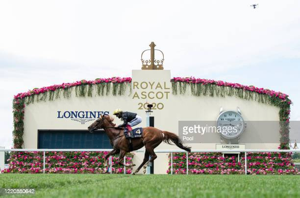Stradivarius ridden by Frankie Dettori crosses the winning line to win his third Gold Cup during Day 3 of Royal Ascot at Ascot Racecourse on June 18,...