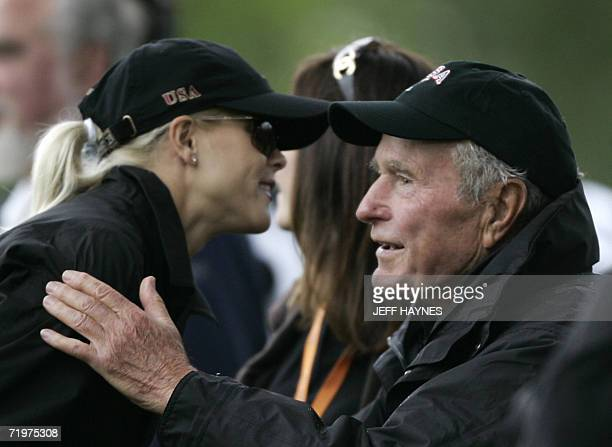 Elin Woods, wife of United States Ryder Cup player Tiger Woods, greets former United States President George Bush as they watch during the morning...