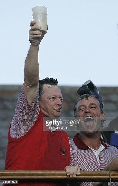 European Ryder Cup Captain Ian Woosnam celebrates after drinking a pint of Guiness beer in one go as Darren Clarke looks on after Europe retained the...