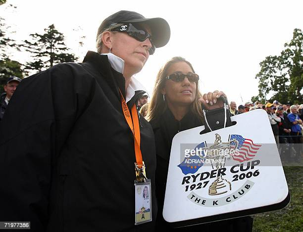 Kim Roberts wife of United States Ryder Cup Assistant Captain Loren Roberts talks with Melissa Lehman wife of Ryder Cup Captain Tom Lehman during the...
