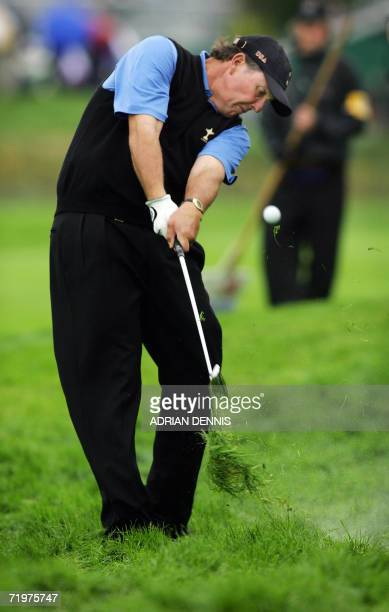 United States Ryder Cup player Phil Mickelson chips off the 15th fairway as he and teammate Chris DiMarco play against Jose Maria Olazabal and Sergio...