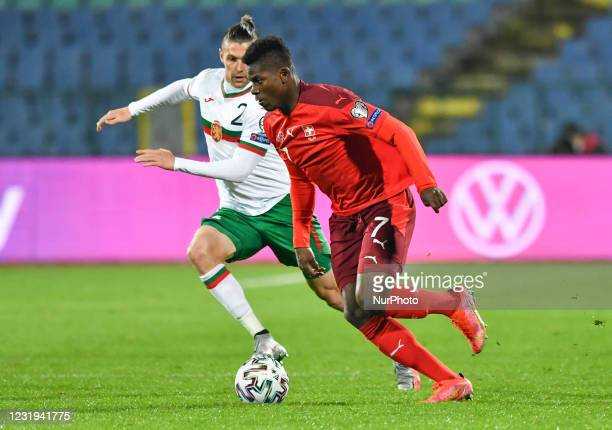 Strahil Popov of Bulgaria is challenged by Breel Embolo of Switzerland during the FIFA World Cup 2022 Qatar qualifying match between Bulgaria and...