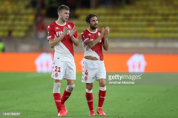 Strahinja Pavlovic and Cesc Fabregas of AS Monaco applaud the fans following the final whistle of the UEFA Europa League group B match between AS...